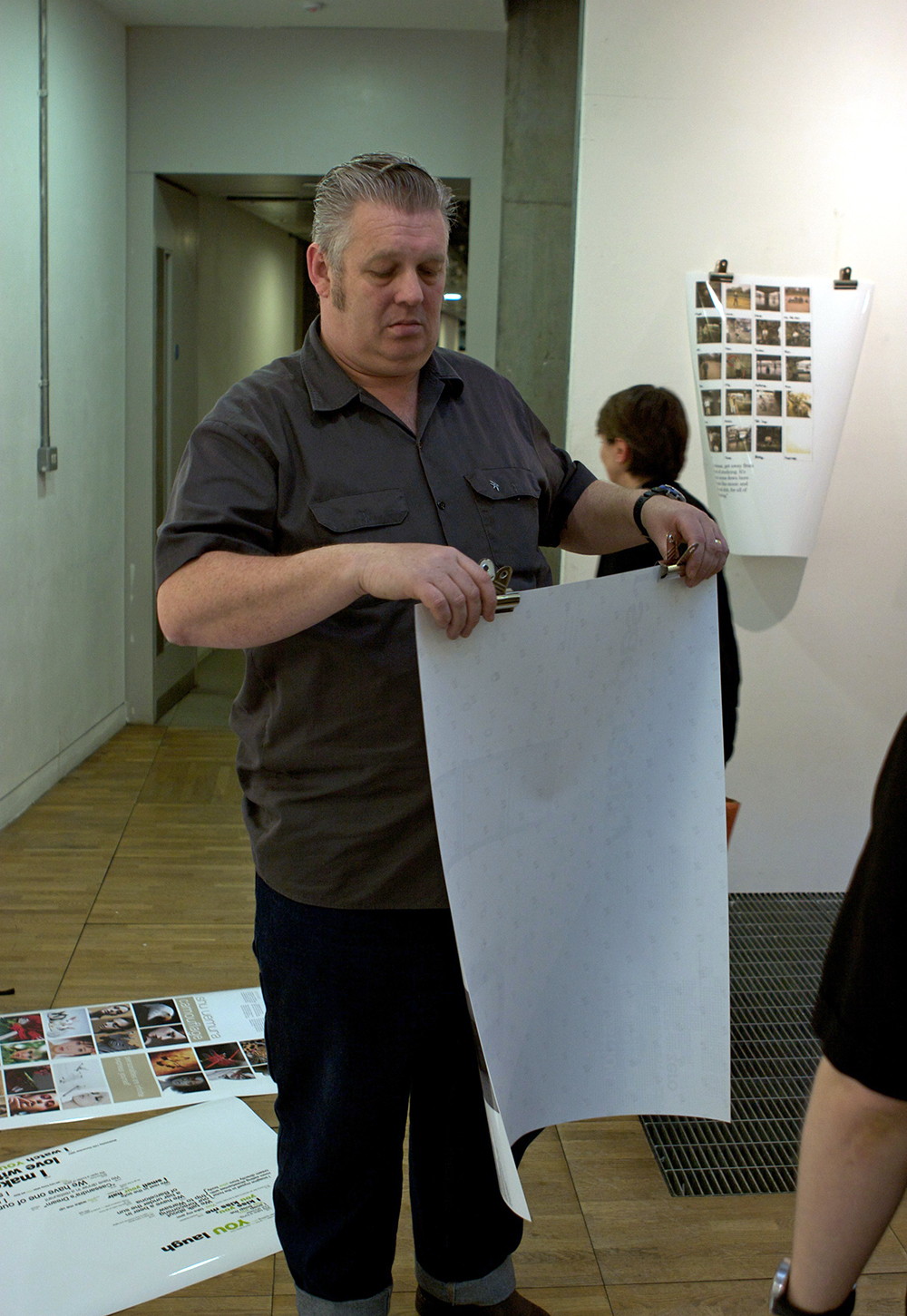 Ian helping put up work for a second year show in 2008 at LCC